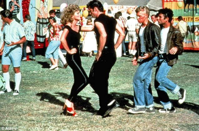 Travolta with Olivia Newton John in classic 1978 film, Grease