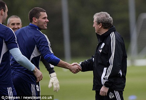 Well done: Hodgson shakes hands with goalkeeper Ben Foster after getting the England job