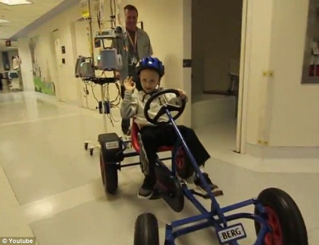 Fun time: One kid even had the hospital rules slackened so he could ride a specially-adapted bike across the lino floors