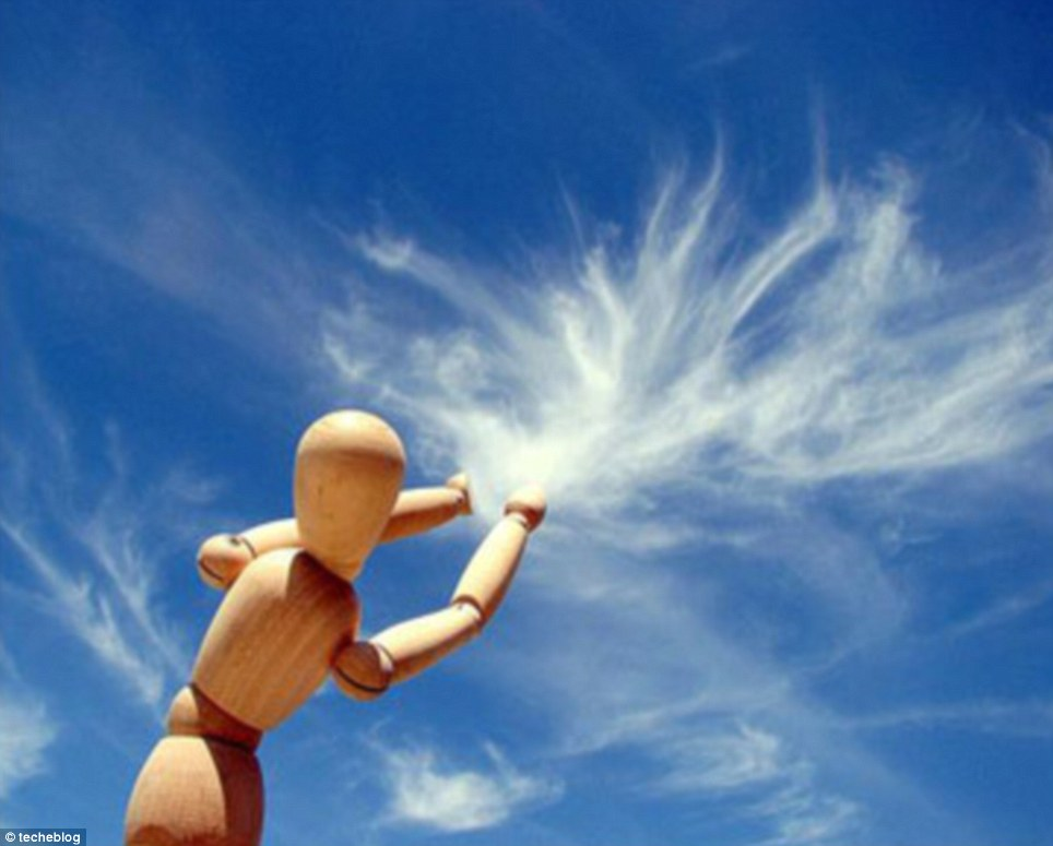 Artistic: A wooden model pulls clouds out of the sky