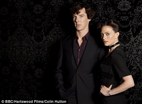 Mystery of missing minutes: Benedict Cumberbatch as Sherlock and Lara Pulver as dominatrix Irene Adler in the episode A Scandal in Belgravia in the BBC's hugely popular Sherlock series
