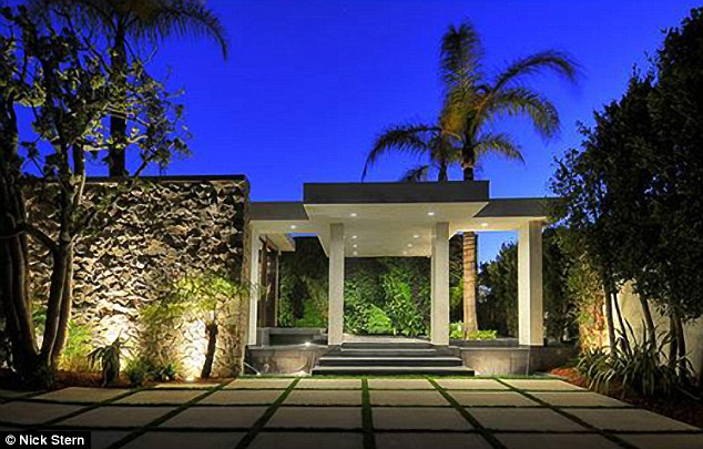 Month to month: The five bedroom home is just a crash pad for the loved up couple until their $21 million Bel Air estate is complete