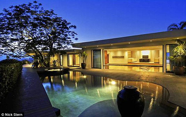 Relaxed: The mansion has a large pool and great views of Los Angeles