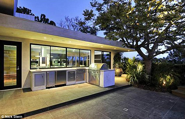 Grill time: The modern home has an outdoor kitchen and barbecue area