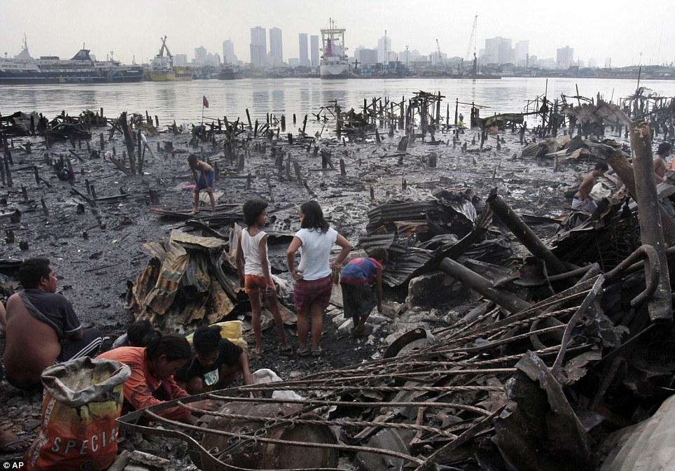Devastation: Some 800 houses built on stilts were destroyed by fire
