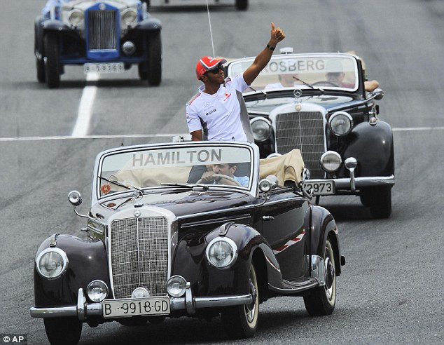 Thumbs up: Hamilton appears in good spirits during the drivers' parade