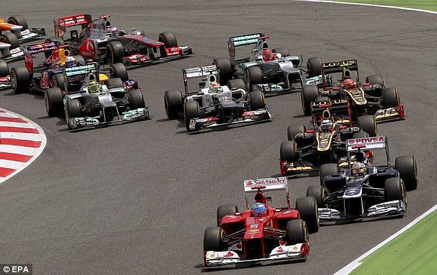 Taking the lead: Alonso gets the jump on Maldonado into Turn 1