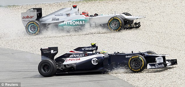 Game over: Schumacher and Senna end up in the gravel at Turn 1