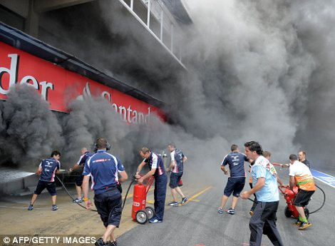 People rushed to the scene with fire extinguishers as the fire took hold