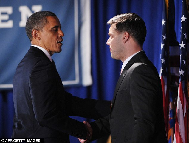 Star quality: Mr Obama at a fundraiser in New York on Monday night with singer Ricky Martin