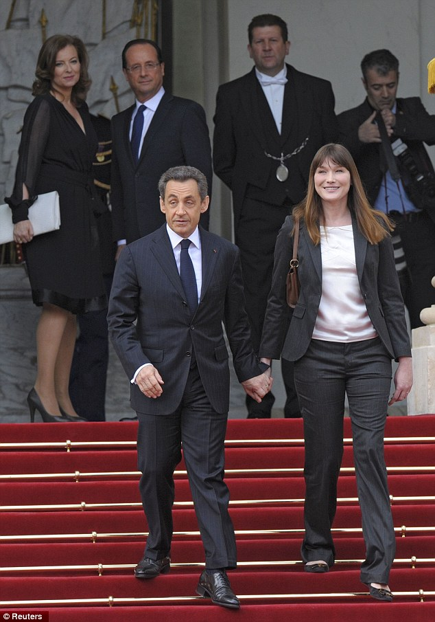 Out with the old: President Francois Hollande and Valerie Trierweiler watch as President Nicolas Sarkozy and former First Lady Carla Bruni-Sarkozy leave the Elysee Palace