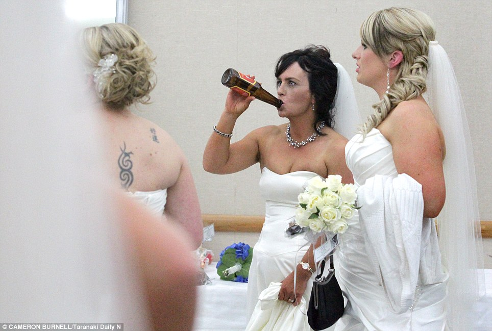 Bridal booze: Katrina Hayman was pictured swigging from a beer bottle during the competition. But not even she could have imagined the furore it would cause