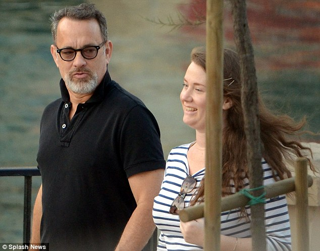 Heading to dinner: The Hollywood superstar seemed to enjoy not being recognised as he headed to a restaurant with his girl