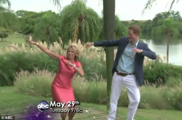 Joking around: During their time together, Ms Couric and Prince Harry goofed around striking a funny pose during their interview in Brazil