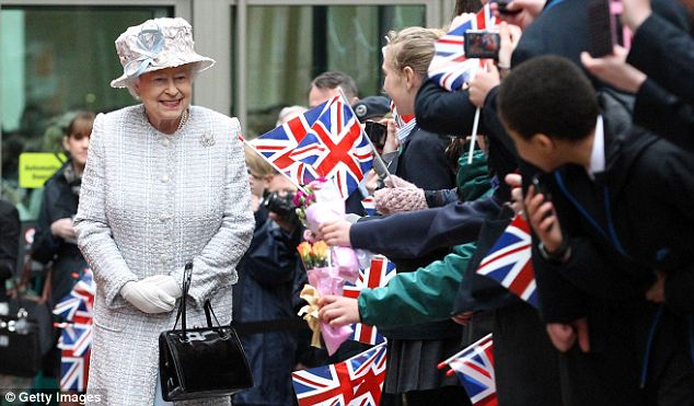 Jubilant! The Queen meets her enthusiastic public after her visit to Glades Shopping Centre in Bromley today