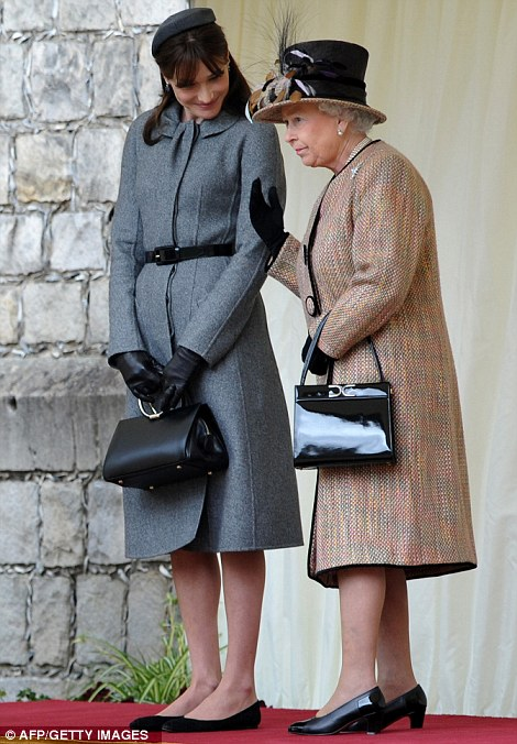 Royal appointment: She curtsied for the Queen during the visit and wore flat shoes so she didn't tower over Her Majesty