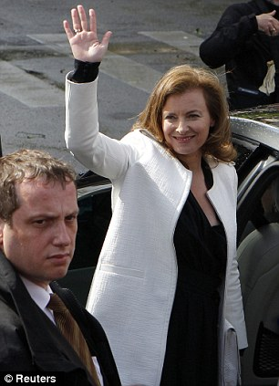 Valerie Trierweiler, the companion of France's new President Francois Hollande, waves to supporters as she leaves after a traditional ceremony