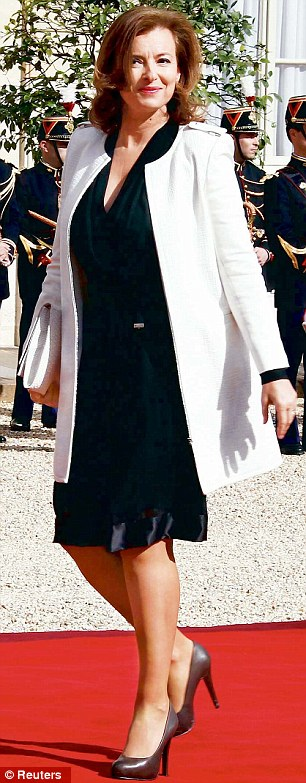 Thigh high: Valerie Trierweiler's dress falls open to reveal her slender legs as she walks in the Tuileries gardens after her partner's inauguration as president