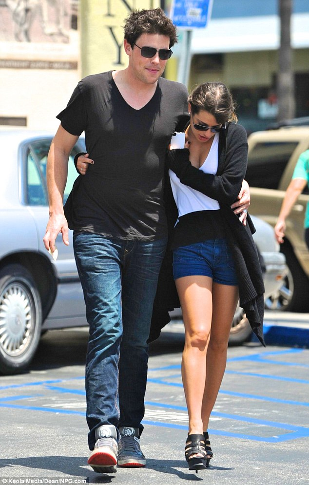 Cuddles: The smitten star affectionately put his arm around her as they made they way to the eatery