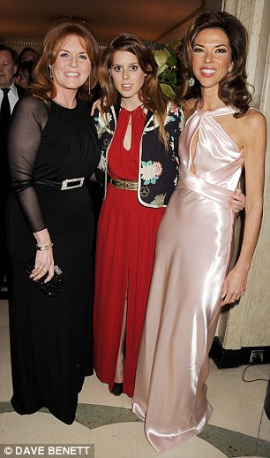 Doing their bit for charity: The mother and daughter pair pose with host of the night Heather Kerzner before heading home (R)