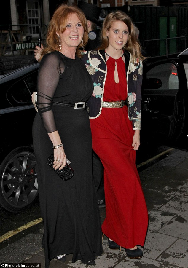 Like mother, like daughter: The Duchess of York Sarah Ferguson and her daughter Princess Beatrice arrive at the Marie Curie Cancer Care fundraiser last night