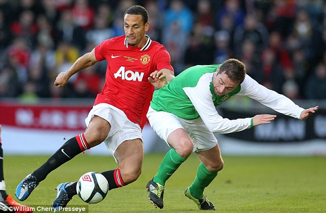 Axed: Ferdinand, seen here playing on Tuesday night, has been left out of the England squad