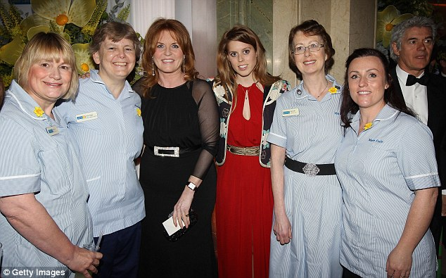 Full of praise: Sarah and Princess Beatrice spent time talking with a group of Marie Curie nurses about the fantastic work that they do