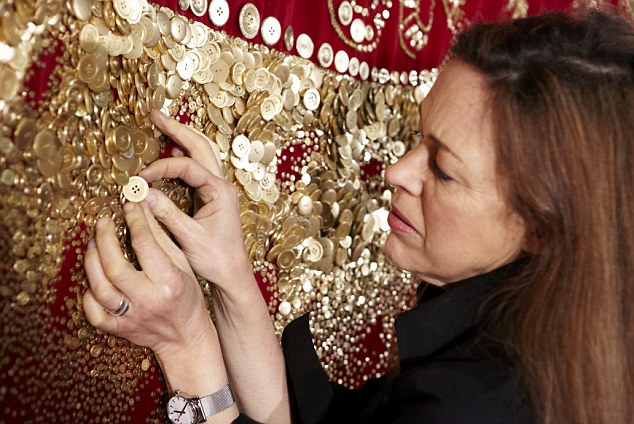 It has taken a team of talented seamstresses four months to sew on half a million golden buttons with 31 miles of thread.