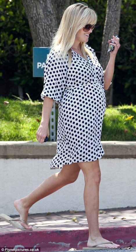 Pins on parade: Reese bared her slim legs in the mini dress, which she teamed with beige flip flops