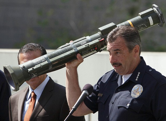 Los Angeles Police Chief Charlie Beck holds up a rocket launcher taken as part of a cache of weapons during weekend gun buyback program.