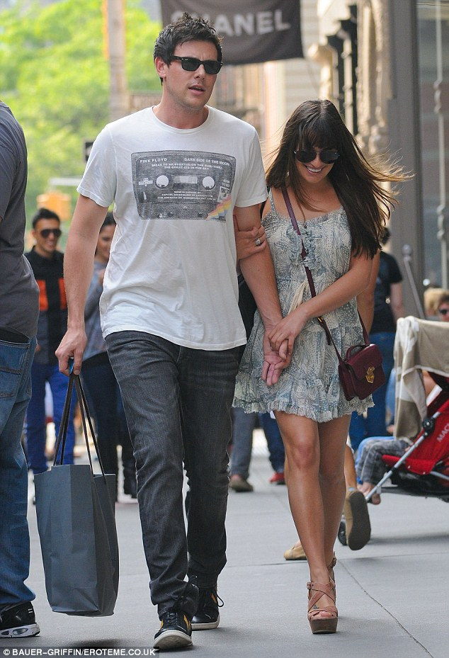 Clinging on: Lea grabs Cory by the arm and hand while he does plays the gentleman and carries the bag
