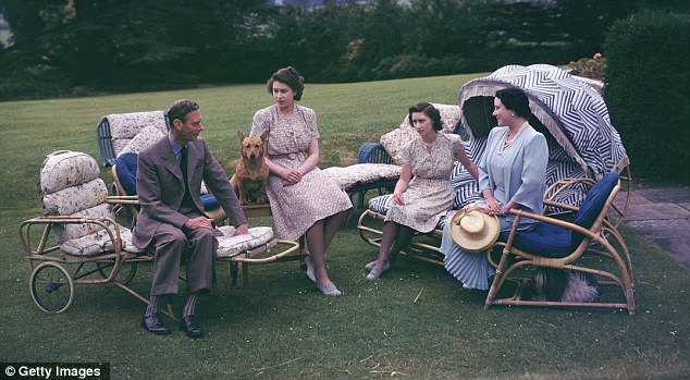 Garden party: Princess Elizabeth, then 20, relaxes in the grounds of Royal Lodge, Windsor, in 1946 with her father King George Vi, sister Margaret, 16, and their mother