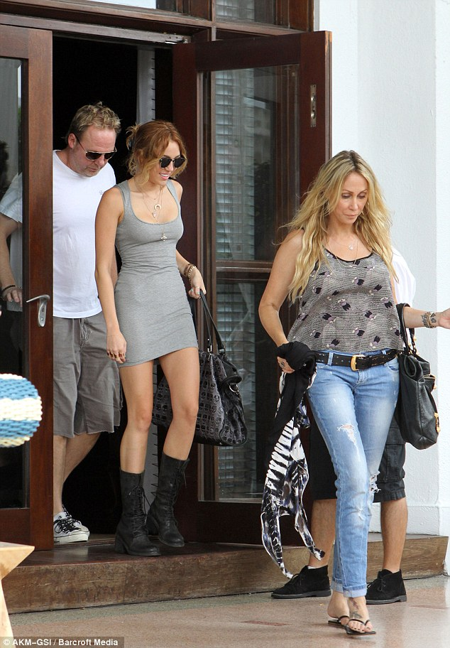 Oh mama: Miley was seen stepping out of her Miami hotel alongside mother Tish