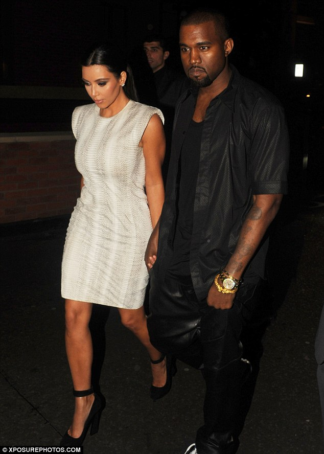 Cheer up! Kim Kardashian and Kanye West look glum as they arrived at the Zuma restaurant in Knightsbridge, London for dinner