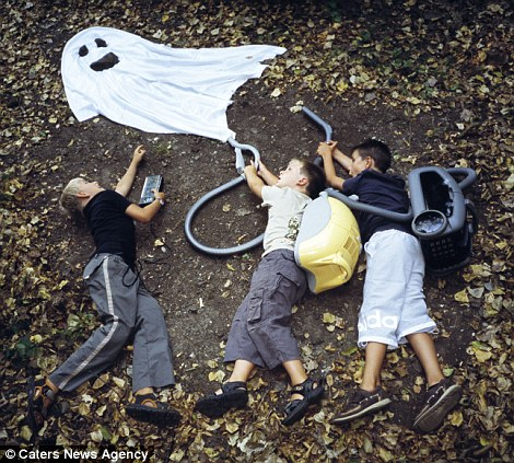 Spooky similarities: There's definitely something strange going on in this neighbourhood... but who are you gonna call? A vacuum and white sheet is used to recreate this scene from the 1984 film Ghostbusters