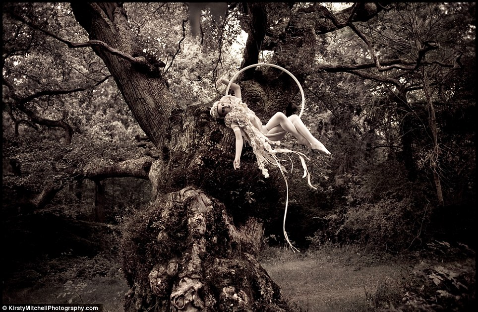 Far, Far Away: A twenties style circus performer swings from a giant tree