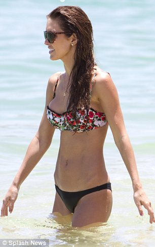 Shady lady: Audrina kept her sunglasses on as she dived into the clear waters to cool off