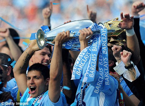 Party time: Manchester City celebrate winning the Premier League title