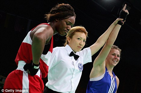 Two sides to every story: Savannah Marshall celebrates her victory over Claressa Shields