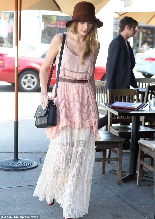 Lunch date: The pair were seen dining in the sunshine at Cafe Roma in Los Angeles