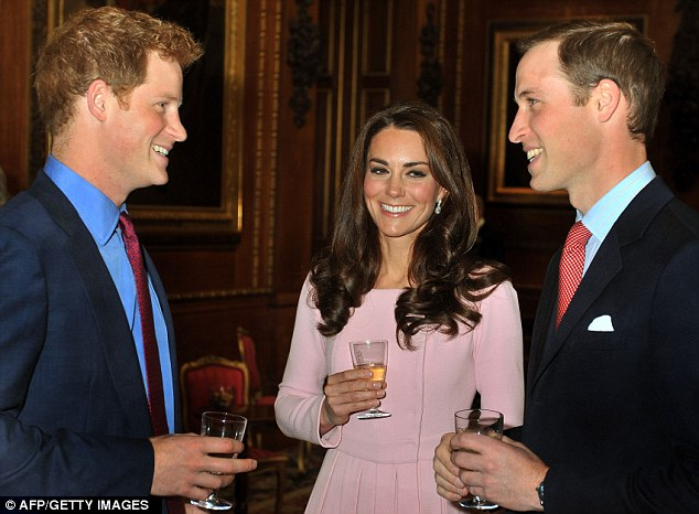 Celebratory mood: The Duke and Duchess of Cambridge were joined by Prince Harry for a drinks reception in the castle's Waterloo Chamber before the lavish lunch