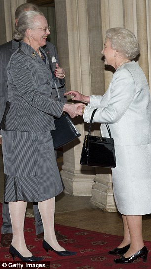 Queen Margrethe of Denmark greets the British monarch warmly...