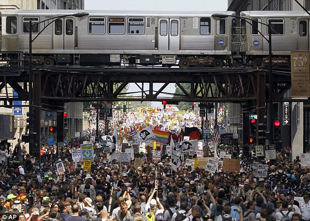 Mass movement: Demonstrators flow out of Grant Park in Chicago on the opening day of the Nato summit