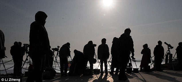 Crowds: People gathered with viewing equipment to watch an annular eclipse that passed through Qingdao, northern China, in 2009