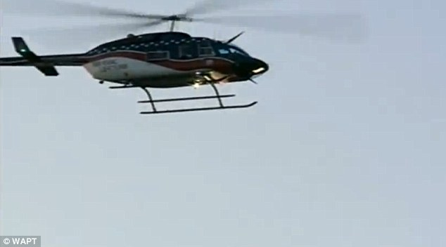 A SWAT team helicopter encircles the prison, were inmates are believed to have taken dozens of hostages