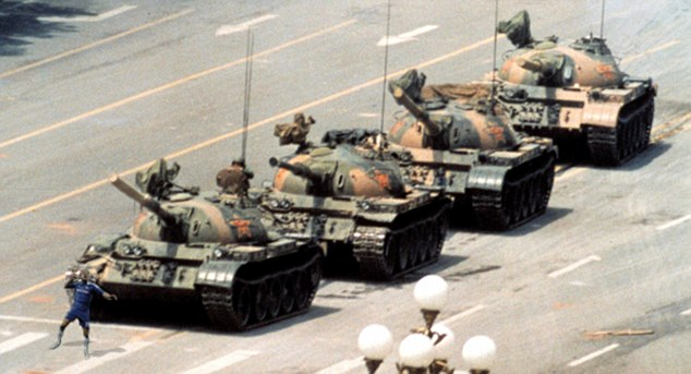 History in the making: Terry holds up tanks in China's Tiananmen Square in 1989 during the bloody crackdown on protesters campaigning for political reform