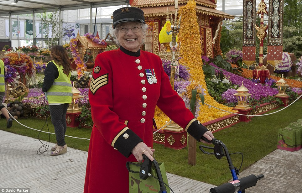 Chelsea Pensioner, Marjorie Cole, who served with the Women's Royal Army Corps for 14 years takes a stroll
