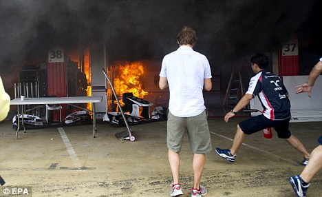 Panic stations: Fire breaks out at the Williams garage