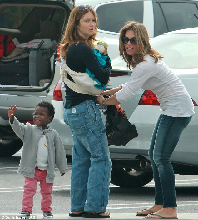 Modern family: Jillian Michaels and her partner Heidi Rhoades with their two-year-old daughter Lukensia and son Phoenix earlier this week
