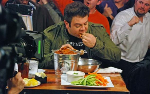 Adam Richman takers on a challenge in front of the cameras when filming Man v Food